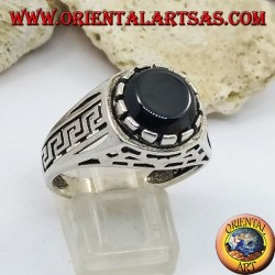Silver ring with flat round onyx and perforated ribs on the sides