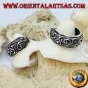 Wide circle chiseled silver earrings with 14 mm floral decorations.