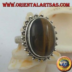 Silver flower ring with large oval cabochon tiger eye surrounded by dots