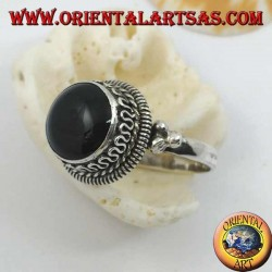 Silver ring with raised round onyx and stripes and continuous serpentine on the sides