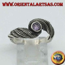 Silver ring with natural round amethyst in an interweaving of threads