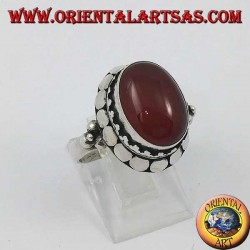 Silver ring with high edge with oval cabochon carnelian
