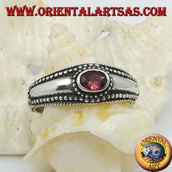 Silver ring with horizontal oval garnet and balls decoration
