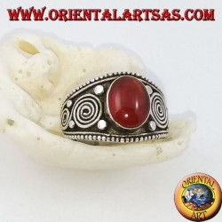 Silver ring with oval carnelian and spirals on the sides