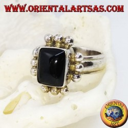 Silver ring with rectangular onyx and row of three balls on each side