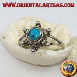 Anello in argento a forma di timone con turchese tondo