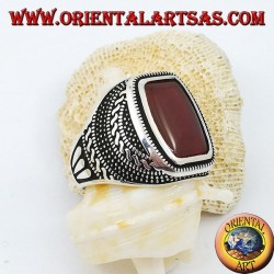 Silver ring with rounded rectangular carnelian in an engraved rose window