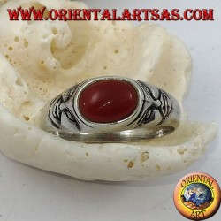 Silver ring with horizontal oval carnelian and tragedy masks on the sides
