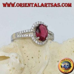 Silver ring with synthetic oval ruby set surrounded by a row of double cubic zirconia