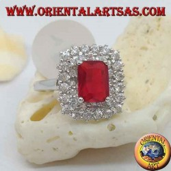 Silver ring with synthetic rectangular ruby set surrounded by two rows of zircons