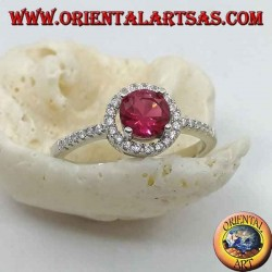 Silver ring with synthetic round ruby set surrounded by a row of zircons