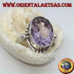 Silver ring with natural faceted oval amethyst and triple dots on the cardinal points