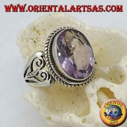 Silver ring with natural oval amethyst and double spiral heart on the sides