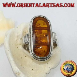Silver ring with oval natural amber of ancient Tibetan origin and striped frame