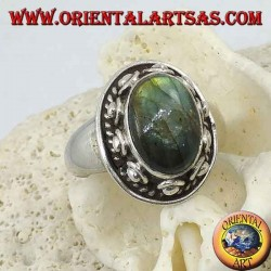 Silver ring with oval labradorite surrounded by studs and braid