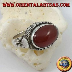 Silver ring with natural oval carnelian sideways surrounded by four rows of dots