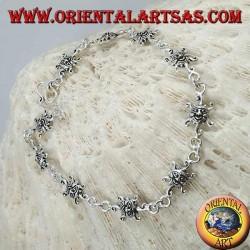 Bracciale in argento morbido con sole con volto inciso