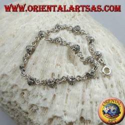 Soft silver bracelet with faces of a native American Indian