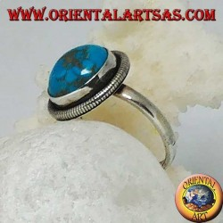 Silver ring with a round cabochon turquoise surrounded by a row of disks (16)