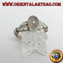 Silver ring with oval moonstone and rhomboid leaf with discs on the sides