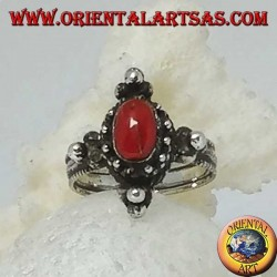 Silver ring with natural oval coral on a Tibetan setting with balls on the cardinal points