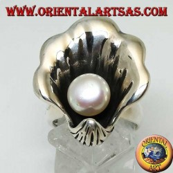Silver ring with natural pearl in the oyster coat