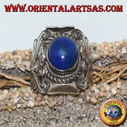 Silver ring with oval cabochon lapis lazuli and Nepalese setting with flower on the sides