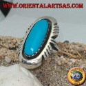 Silver ring with elongated oval turquoise on a smooth frame ruled on the sides