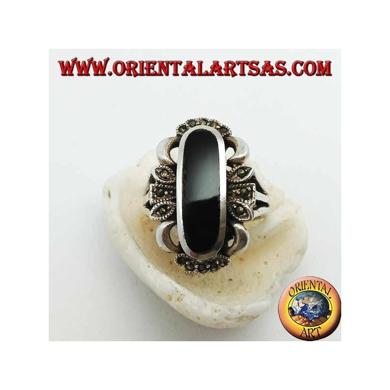 Silver ring with elongated oval onyx and decoration with marcasites on the 4 cardinal points