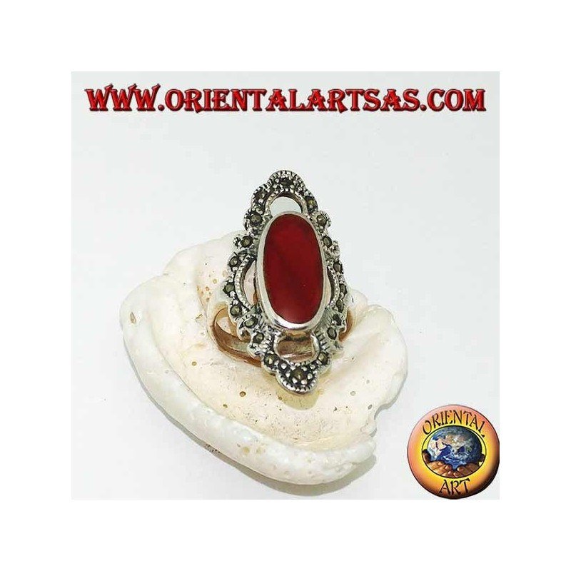 Silver ring with elongated oval carnelian surrounded by a wavy line of marcasite