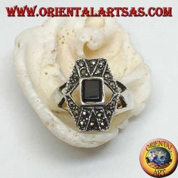 Silver ring with rectangular onyx overlapping X and hexagon with marcasite