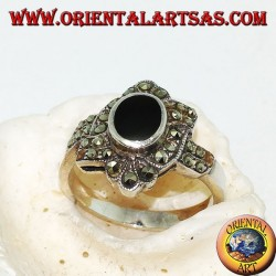 Silver ring with oval onyx surrounded by marcasite with an oblique band