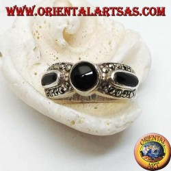 Silver band ring with round onyx between two ovals surrounded by