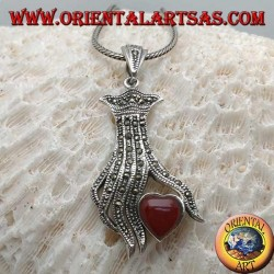 Silver pendant, carnelian heart between the fingers of a hand studded with marcasite