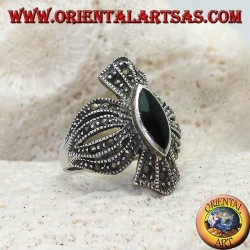Silver ring with shuttle onyx on a rounded cross frame studded with marcasite