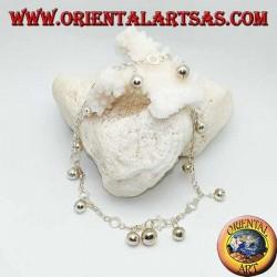 Cavigliera in argento con campanellini pendenti e dischetti alternati