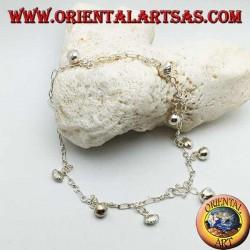 Bracelet de cheville en argent avec alternance de cloches et de coquilles suspendues