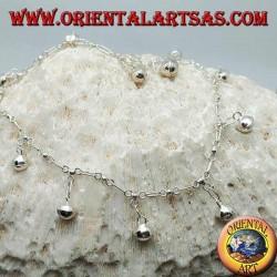 Bracelet de cheville en argent avec des cloches suspendues le long de toute la chaîne