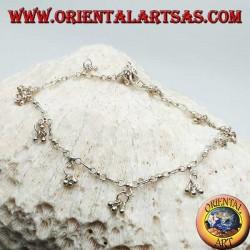 Bracelet de cheville en argent avec une série de trois boules suspendues avec une cloche