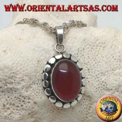 Silver pendant with oval cabochon carnelian surrounded by diskette studs