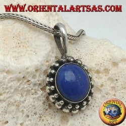 Silver pendant with oval lapis lazuli surrounded by two rounds of spheres