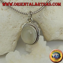 Silver pendant with oval moonstone surrounded by subtle weaves