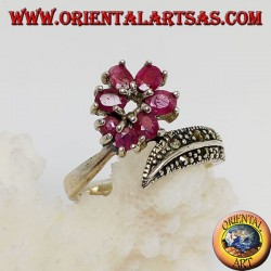 Silver ring with a circle of natural round rubies set and a feather with marcasites