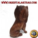 Lion sculpture seated in 30 cm Suar wood carved by hand in a single block