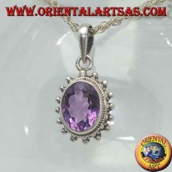 Silver pendant with faceted oval natural amethyst surrounded by intertwining and balls