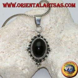 Silver pendant with oval onyx cabochon surrounded by subtle weave, dots and the four cardinal points