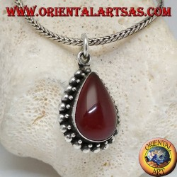 Silver pendant with teardrop cabochon carnelian surrounded by a row of small and large balls