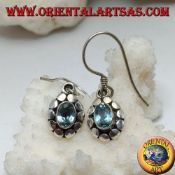 Silver earrings with natural oval blue topaz surrounded by discs