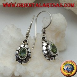 Silver earrings with natural oval peridot surrounded by discs