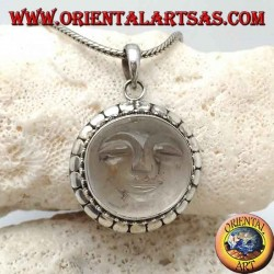 Silver pendant with sun hollowed out on a round rock crystal and diskette contour